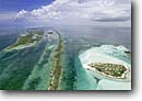 Stock photo. Caption: Double-Breasted Cay Ragged Island Chain Bahamas Atlantic Ocean -- oceans bahama tropical warm tourist destination destinations dive diving site sites clear water clean sandy beach beaches secluded beautiful clouds idyllic ideal remote aerial aerials photographs photography desert deserted mangroves islands coral reefs