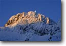 Stock photo. Caption: Moon rise over the Piz Buin Ochsentaler Glacier Silvretta,  The Alps Austria, Europe -- Keywords: snow tracks track mountains european cold winter scenic scenics landscape landscapes sunny mountain snow moons moonrise stunning glaciers destination destinations travel skiing dramatic
