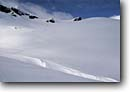 Stock photo. Caption: Skiers on the Vermunt Glacier Silvretta Rhaetian Alps Vorarlberg, Austria -- Keywords: people outdoor recreation crosscountry freedom solitude europe skiing snow mountains expanse sports sport cold winter scenic scenics landscape landscapes traverse sunny mountain extreme skier european destination destinations glaciers sunny clear