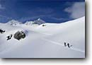 Stock photo. Caption: Skiers on the Vermunt Glacier Silvretta Rhaetian Alps Vorarlberg, Austria -- Keywords: people outdoor recreation crosscountry freedom solitude europe skiing snow mountains expanse vast sports sport cold winter scenic scenics landscape landscapes traverse sunny mountain extreme skier european destination destinations glaciers clear climb
