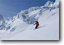 Stock photo. Caption: Downhill skiing Ochsentaler Glacier Silvretta,  The Alps Austria, Europe -- Keywords: people outdoor recreation crosscountry freedom solitude excitement skiers snow mountains expanse sports sport cold winter scenic scenics landscape landscapes traverse sunny mountain extreme skier european destination destinations glaciers clear alpine