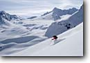 Stock photo. Caption: Downhill skiing Ochsentaler Glacier Silvretta,  The Alps Austria, Europe -- Keywords: people outdoor recreation freedom solitude excitement skiers snow mountains expanse vast sports sport cold winter scenic scenics landscape landscapes traverse sunny mountain extreme skier european destination destinations glaciers clear alpine powder