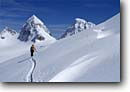 Stock photo. Caption: Cross country skiing below the Piz Buin Ochsentaler Glacier The Alps Silvretta, Austria, Europe -- Keywords: people outdoor recreation crosscountry freedom solitude excitement skiers snow mountains expanse sports sport cold winter scenic scenics landscape landscapes traverse sunny mountain extreme skier european destination destinations glaciers clear alpine