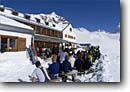 Stock photo. Caption: Crowd at Wiesbadener Hutte The Alps Silvretta, Austria Europe -- people outdoor recreation crosscountry excitement skiers snow mountains expanse sports sport cold winter scenic scenics landscape landscapes  sunny mountain extreme skier european destination destinations clear alpine person lodge huts backcountry