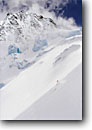 Stock photo. Caption: Backcountry skier skiing near ice fall   on the Alpiner Ferner Glacier Oberbergtal, The Alps Stubaital, Austria, Europe -- people outdoor recreation crosscountry freedom solitude excitement skiers snow mountains expanse vast sports sport cold winter scenic scenics landscape landscapes sunny mountain extreme skiing european destination destinations glaciers clear alpine drama