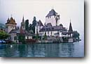 Stock photo. Caption: Castle in Oberhofen Lake of Thun Berner Oberland Switzerland -- castles lakes mountain mountains fall autumn travel tourist destination destinations world europe european balance museum museums cloudy foggy quaint architecture building buildings landmark landmarks real turrets towers swiss turret scenic thoune bern