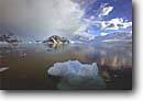 Stock photo. Caption: Antarctic Peninsula Southern Ocean Antarctica -- Keywords: iceberg icebergs severe extreme weather climate global warming international research south pole continent southern coastal glacier glacial glaciers dramatic skies snow