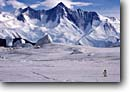 Stock photo. Caption: Mt. Herschel & Adelie penguin Admiralty Range Ross Sea Southern Ocean, Antarctica -- iceberg icebergs severe extreme weather climate global warming international research south pole continent southern coastal penguin habitat glacier glacial glaciers bird birds snow solitary mount alone single vast
