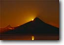 Stock photo. Caption: Sunrise over Osorno Volcano   and El Puntiagudo from Puerto Montt Andes Mountains,  Chile South America -- travel destination destinations attraction attractions tourist international volcanoes volcanos volcanic cone shape shaped conical sun sunrises orange south america latin landmark landmarks