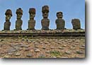 Stock photo. Caption: Six of the seven Maoi   that make up Ahu Nau Nau Easter Island or Rapa Nui Southeastern Pacific Ocean -- Keywords: statues world heritage site sites carvings mysterious mystery giant large landmark landmarks landscape landscapes national park parks islands south heads head torso torsos basalt ancient carving flowers mystical rock scenic scenics facing ocean walls wall
