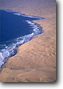 Stock photo. Caption: Aerial view of the Skeleton Coast Namib Desert Namibia Africa -- dune dunes sand atlantic coasts coastal deserts african surf wave waves aerials geology geologic habitat contrasts contrast blue ocean ocean artistic nature shoreline shorelines