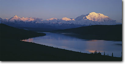 Stock photo. Caption: Mount McKinley and the Alaskan Range   from Wonder Lake Denali National Park Alaska -- parks tourist attraction attractions united states america destination travel feature features mount sunrise northern panoramic panoramics destination destinations ranges mountain mountains peak peaks evening light lakes landscape landscapes