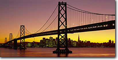 Stock photo. Caption: San Francisco-Oakland Bay Bridge   and San Francisco   from Yerba Buena Island Bay Area, California -- cityscape cityscapes west pacific ocean highway travel destination bridges dusk strength symbol city cities landmark landmarks tourist suspension span spans sunset sunsets icon skyline skylines landscape lansdcapes ocean panoramic panoramics panoramas