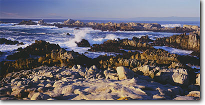 Stock photo. Caption: Point Pinos towards Santa Cruz Lighthouse Reservation Park Pacific Grove,  Monterey Peninsula Monterey County,  California -- pacific ocean coasts united states  seastack west coasts seascape seascapes travel tourist destination destinations headland headlands rugged coastline attraction attractions expansive rocky panoramic panoramics panoramas clear skies blue sunny waves