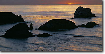 Stock photo. Caption: Seastacks at Pacific Valley Big Sur Los Padres National Forest Monterey County, California -- pacific ocean coast west coasts seascape seascapes travel tourist destination destinations coastal vacation family coastline coastal panoramic panoramics panoramas panorama landscape landscapes views view scenic scenics scenes seashore coastlines oceans
