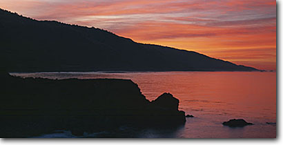 Stock photo. Caption: Santa Lucia Range at sunrise Big Sur at Lime Kiln Point Los Padres National Forest California -- pacific ocean coast united states america west coasts seascape seascapes travel tourist destination destinations coastal vacation family coastline coastal panoramic panoramics panoramas panorama landscape landscapes views view scenic scenics scenes