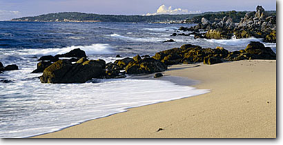 Stock photo. Caption: Pebble Beach from Monastery Beach Carmel Bay Carmel River State Beach Monterey County, California -- pacific ocean coast united states west coasts seascape seascapes travel tourist destination destinations  coastal vacation beaches sandy sand popular shoreline shorelines wave waves surf panoramic panoramics panoramas panorama sunny clear blue skies views