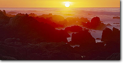 Stock photo. Caption: Point Pinos Lighthouse Reservation Park Pacific Grove Monterey Peninsula Monterey County, California -- seascape seascapes travel tourist destination destinations ocean surf wave waves headlands coastal coast west spring coastline isolated secluded dramatic sunset sunsets coastlines oceans orange horizon line scenic panoramic panoramics panoramas panorama