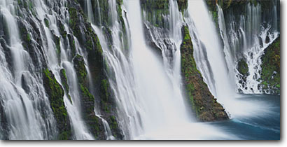 Stock photo. Caption: Burney Falls,  Hat Creek McArthur Burney Falls State Park Shasta  County Cascade Range,  California -- waterfall waterfalls winter frozen freezing parks creeks united states ranges cold icey tourist destination destinations attraction attractions springs travel cascades background backgrounds panoramic panoramics panoramas panorama scenics scenes water