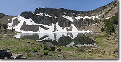 Stock photo. Caption: Patterson Lake below Warner Peak South Warner Wilderness Warner Mountains, Modoc National Forest Modoc County, California -- panoramic panoramics united states america northern timberline peaks wildernesses backcountry backpacking hiking summer highcountry summits sunny blue sky clear skies reflection reflections landscape landscapes altitude high lakes snow above alpine