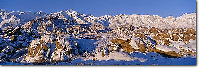 Stock photo. Caption: Alabama Hills Lone Pine Peak and Mt. Whitney Sierra Nevada California -- united states america landscape landscapes highcountry mountains sierras winter snow snowy movie sets foothills panoramic panoramics panoramas
