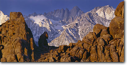 Stock photo. Caption: Alabama Hills   and Mt. Whitney Eastern Sierra Nevada Inyo County,  California -- panorama panoramas panoramic panoramics landscape landscapes clear scenic scenics scene canyons distance view views vista vistas mountains deserts snow covered sierras mountain contrast destination destinations movie movies iconic icons highest landmarks