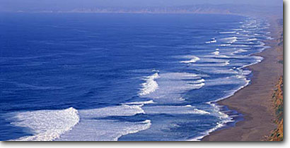 Stock photo. Caption: Point Reyes Beach   from Point Reyes Point Reyes National Seashore Marin County, California -- panorama panoramas panoramic panoramics united states america seascape seascapes pacific ocean surf waves eternal distance cliffs seashores beaches wave