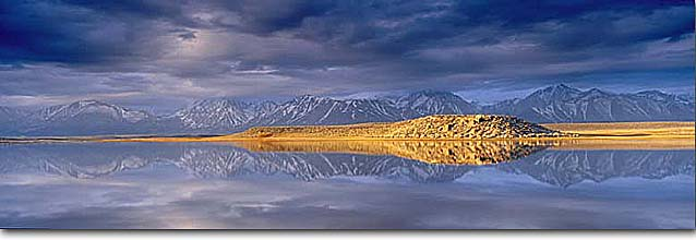 Stock photo. Caption: Eastern Sierra Nevada   reflect in Alkali Lake Long Valley Mono County, California -- united states america landscape landscapes solitude lake lakes mountains sierras peace peaceful evening light glassy mount reflection reflections symetry symetrical panoramic panoramics panoramas