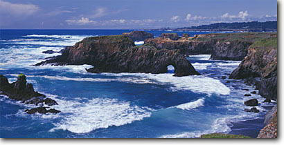 Stock photo. Caption: Sea arch Mendocino Headlands State Park Mendocino County California -- united states seascape seascapes pacific ocean coves coast west seastacks rural travel tourist destination destinations west secluded beach beaches remote isolated arches waves wave surf coastal panoramic panoramics panoramas clear sunny scenic views