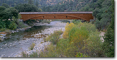 Stock photo. Caption: Bridgeport Covered Bridge   built in 1862 South Fork Yuba River Sierra Nevada,  California -- united states america sierras  bridges span spans spanning  rivers historic historical nostalgia nostalgic americana panoramic panoramics panoramas