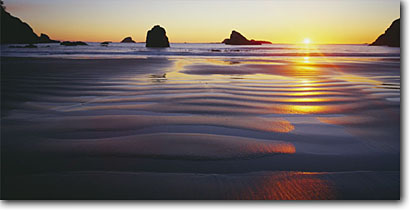 Stock photo. Caption: College Cove Trinidad State Beach Humboldt County Trinidad, California -- ripple ripples beaches sunburst sunsets seastack seastacks western pacific coast coastal soft poetic sand sandy romantic quiet peaceful secluded beaches coastline breathtaking panoramic panoramics panoramas sunbeams panorama stunning smooth scenic western