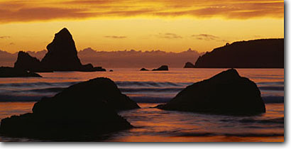 Stock photo. Caption: Trinidad Head   from Houda Point Beach Trinidad Humboldt County,  California -- seastacks pacific ocean coast seastack west coasts seascape seascapes travel tourist destination destinations golden coastline coastlines family weekend getaway sunsets panoramic panoramics panoramas panorama western views scenic scenics beaches sandy