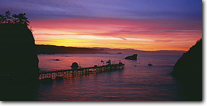 Stock photo. Caption: Winter sunrise Trinidad Pier,  Trinidad Bay Trinidad Humboldt County,  California -- panoramic panoramics panoramas panorama seastack piers sunrises harbor harbors harbour harbours bays winter seascape seascapes coast pacific coastal united states america travel tourist destination destinations dramatic landscapes scenic views scenics