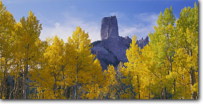 Stock photo. Caption: Aspens & Chimney Rock, Owl Creek Pass Uncompahgre National Forest San Juan Mountains Rocky Mountains, Colorado -- aspen tree trees fall autumn color forests united states mountains rockies peak peaks colours colour elegant majestic solitude peace peaceful strong spiritual panoramic panoramics panoramas panorama landscape landscapes scenic clear sunny scenic views