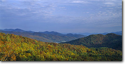 Stock photo. Caption: Lookoff Mountain and Smokehouse Knob   from Black Rock Mountain Black Rock Mountain State Park Rabun County,  Georgia -- united states fall autumn hollow hollows canyons south southern states southeast mountains appalachians appalachia landscape landscapes tourist attraction attractions deep valley valleys parks vast panoramic panoramics panoramas panorama cloudy scenic