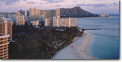 Stock photo. Caption: Waikiki Beach and Diamond Head Honolulu Island of Oahu Hawaii -- panorama panoramas panoramic panoramics tourist destination destinations coastal tropical beaches seashore seashores sandy sand hawaiian tropic paradise tropics vacation warm winter islands landscapes hotels hotel buildings people landmark landmarks