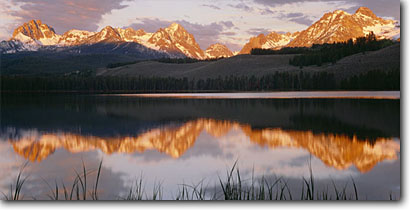 Stock photo. Caption: Sawtooth Range and Little Redfish Lake Sawtooth National Recreation Area Sawtooth National Forest Rocky Mountains, Idaho -- panorama panoramic panoramics panoramas landscape landscapes scenic scenics scene attraction attractions destination destinations landmark landmarks rockies peaks summer  family vacation wild nature areas lakes salmon spawning forests alpenglow