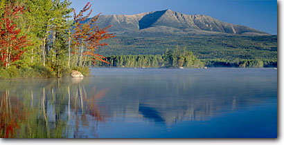Stock photo. Caption: Togue Pond   and Mt. Katahdin Baxter State Park Maine, New England -- panorama panoramic panoramics panoramas sunny blue landscape landscapes parks northern north clear scenic scenics scene waterfall waterfalls rivers fall autumn foliage northern northeast eastern calm quiet interlude patience inspire