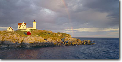 Stock photo. Caption: Cape Neddick Light (Nubble Light) Sohier Park York County Maine, New England -- panorama panoramic panoramics panoramas seascape seascapes tourist destination destinations  lighthouses station stations parks lighthouse rainbow rainbows coast coastal coastline coastlines landscape landscapes scenic scenics ocean protection rock solid