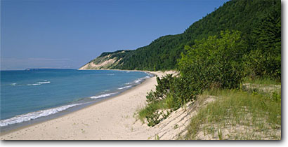 Stock photo. Caption: Empire Bluffs and Lake Michigan  from Platte Bay Sleeping Bear Dunes National Lakeshore Lower Peninsula, Michigan -- panorama panoramic panoramics panoramas attraction attractions northern landscape landscapes scenic scenics great lakes summer destinations sunny clear blue skies shore sandy beach beaches sand lakeshores dune destinations