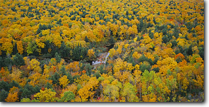 Stock photo. Caption: Carp River Valley   from Lake of the Clouds Escarpment Porcupine Mountains Wilderness State  Park, Upper Peninsula,  Michigan -- united states forests fall autumn color colors rivers midwest midwestern views view overlook overlooks parks great lakes region wildernesses valley distance freedom colour colours panoramic panoramics panoramas panorama landscape landscapes yellow scenics