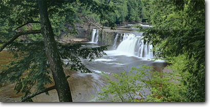 Stock photo. Caption: Manabezho Falls, Presque Isle River Porcupine Mountains Wilderness State Park Upper Peninsula, Michigan -- panorama panoramas panoramic panoramics attraction attractions northern landscape landscapes scenic scenics great lakes destinations rivers summer water flowing destination creek creeks waterfall waterfalls parks large spring trees wilderness mountain
