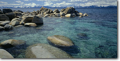 Stock photo. Caption: Granite erratics, Sand Harbor Lake Tahoe Nevada State Park Lake Tahoe Sierra Nevada,  Nevada -- panorama panoramas panoramic panoramics landscapes landscape snow snowy covered lakes sierras clear sunny cold bright clean destination destinations scenics scenic tourist travel lakes attraction attractions clear parks view views classic rocks shore