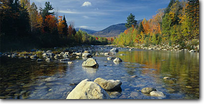 Stock photo. Caption: West Branch Peabody River White Mountain National Forest White Mountains New Hampshire, New England -- panorama panoramas panoramic panoramics creek creeks rivers  tourist travel destination destinations attraction attractions grace autumn fall northern northeast northeastern reflections reflecting light forests rocks rock