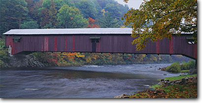 Stock photo. Caption: Forkesville Covered Bridge Loyalsock Creek Forkesville Sullivan County,  Pennsylvania -- united states america historic nostalgia nostalgic travel vacation tree trees bridges rural americana spans spanning historical bridges panoramic panoramics panoramas panorama spanning autumn fall color foliage scenic scenics views intact rivers creeks