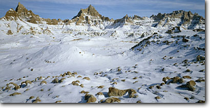 Stock photo. Caption: Winter afternoon Badlands National Park South Dakota -- panorama panoramas panoramic panoramics parks united states america tourist travel destination destinations attraction attractions landscape landscapes scenic scenics snowfall snow cold sunrises peaks peak badland freezing