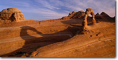 Stock photo. Caption: Delicate Arch  and shadow Arches National Park Colorado Plateau,  Utah -- desert deserts rock canyons country plateaus landscape landscapes tourist travel destination destinations family vacation sandstone arches famous slickrock windows window panoramic panoramics sunny clear landmark panorama landmarks dramatic scenics scenic