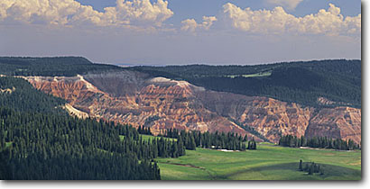 Stock photo. Caption: Cedar Breaks National Monument   from Brian Head Dixie National Forest Colorado Plateau,  Utah -- parks rock united states america canyon country plateaus erosion landscape landscapes meadow meadows monuments panoramic panoramics panoramas panorama elevation views scenic scenics sunny clear blue skies puffy clouds long vistas