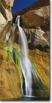 Stock photo. Caption: Lower Calf Creek Falls Escalante-Grand Staircase National Monument Colorado Plateau,  Utah -- united states america desert deserts rock canyons country plateaus landscape landscapes tourist travel destination destinations family vacation sandstone waterfall waterfalls cascades plunge pool remote panoramic panoramics clear blue sunny skies panorama