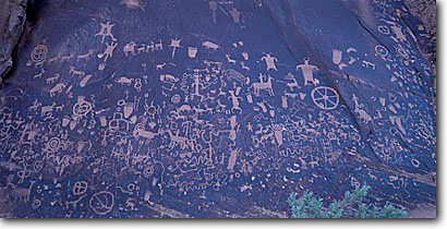 Stock photo. Caption: Petroglyphs on Newspaper Rock Indian Creek Canyon Newspaper Rock State Historical Park Colorado Plateau,  Utah -- united states petroglyph rock art anasazi native american ancient archeological site sites culture cultural communication archeology mysterious spiritual flying squirrel bighorn sheep horseman parks panoramic panoramics panoramas animal animals humans